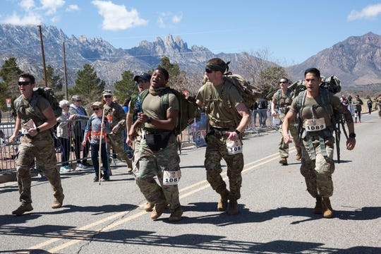 Teammates push each other to reach the finish line at the 30th Bataan Memorial Death March on Sunday, March 17, 2019.