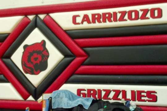 Carrizozo's team mascot is a grizzly bear.