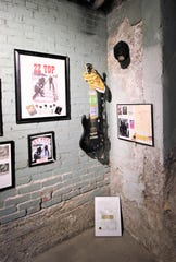 A signed guitar by AC/DC hangs on a wall at the Carrizozo Rock and Roll Hall of Fame. The collection of rock memorabilia now has a permanent home.