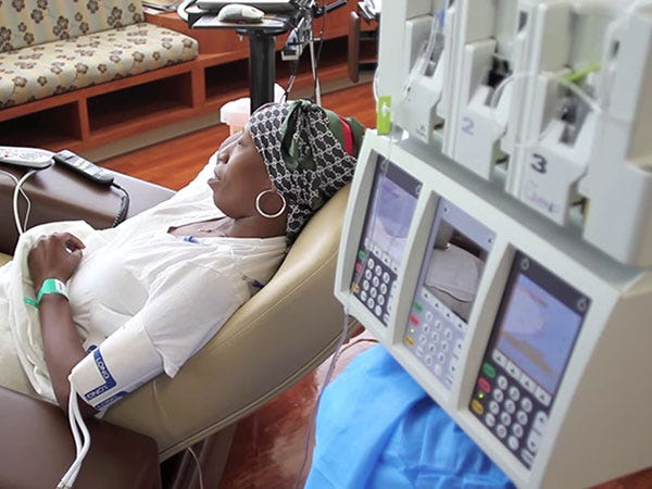 A patient is hooked up for chemotherapy.