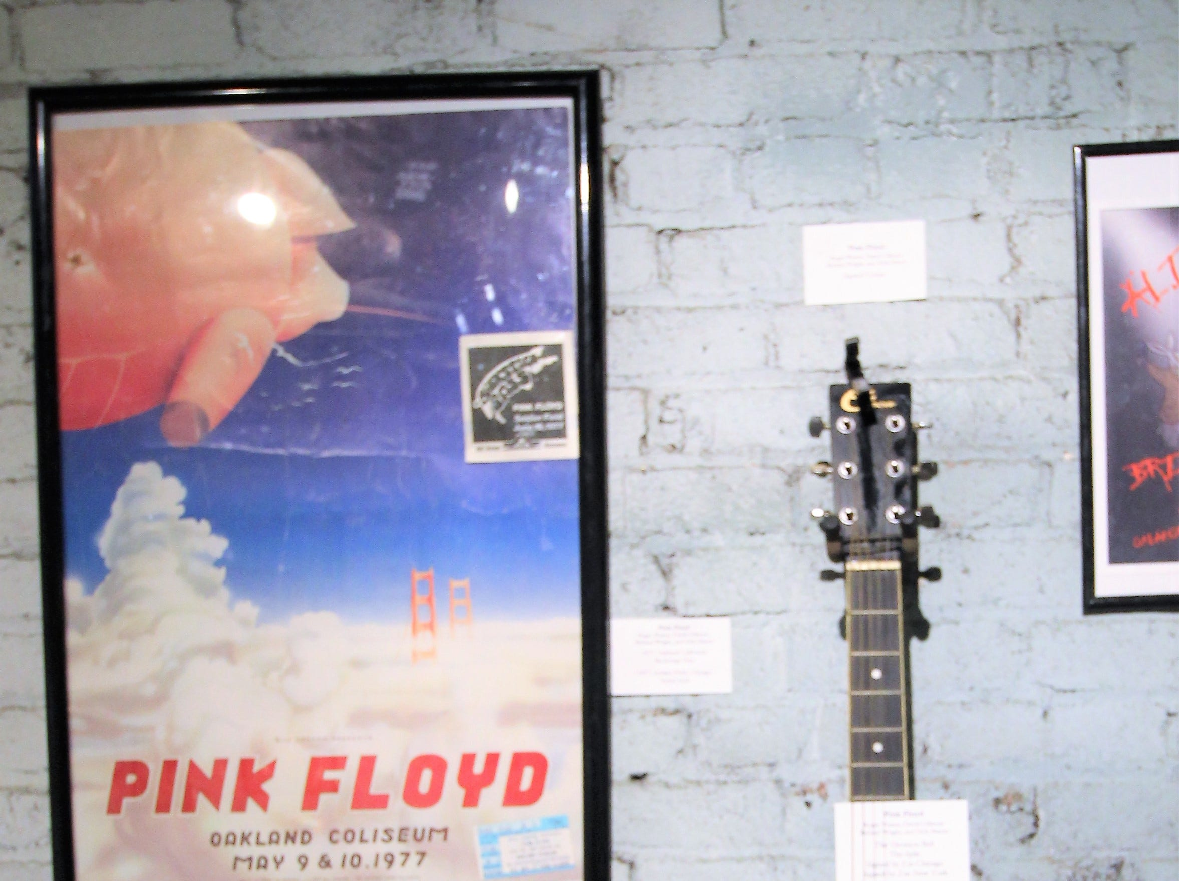 A singed guitar when the band had split. decades ago. It will remain on the wall at the Carrizozo Rock and Roll Hall of Fame.
