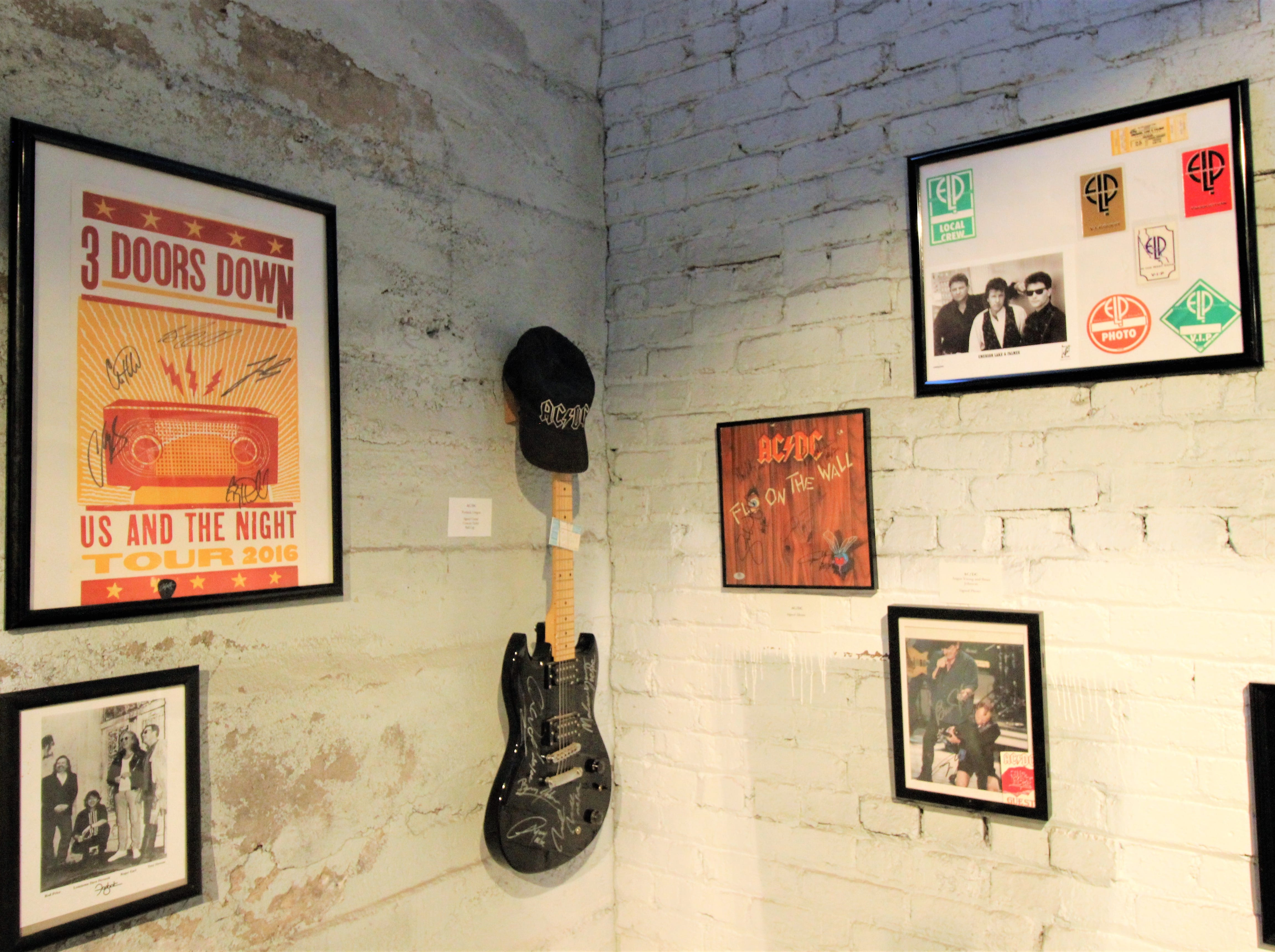 A singed guitar by AC/DC may be in a corner of the room, but it is a significant part of the collection from owner James Lane on display at the Carrizozo Rock and Roll Hall of Fame.