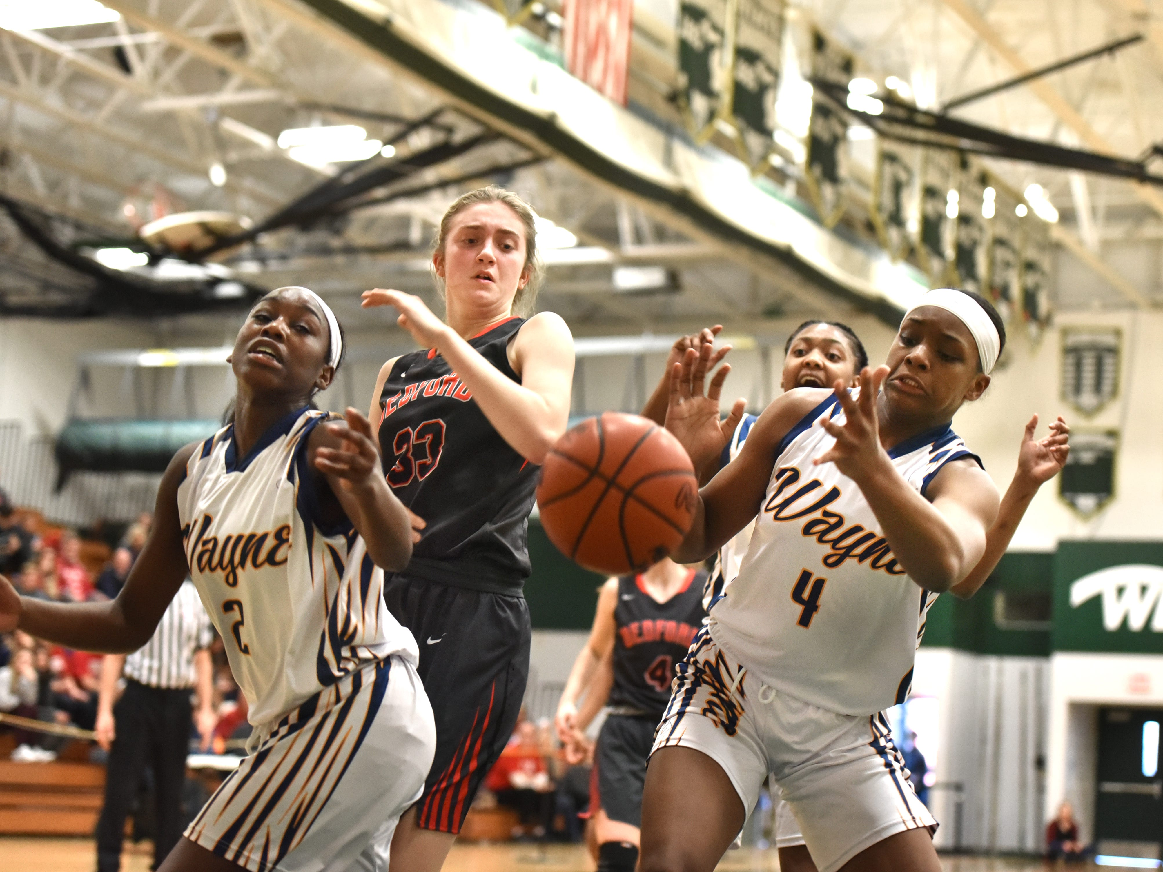 Wayne Memorial Zebras Jordan Wright, left, and Alanna Micheaux watch as a rebound drops out of sight.