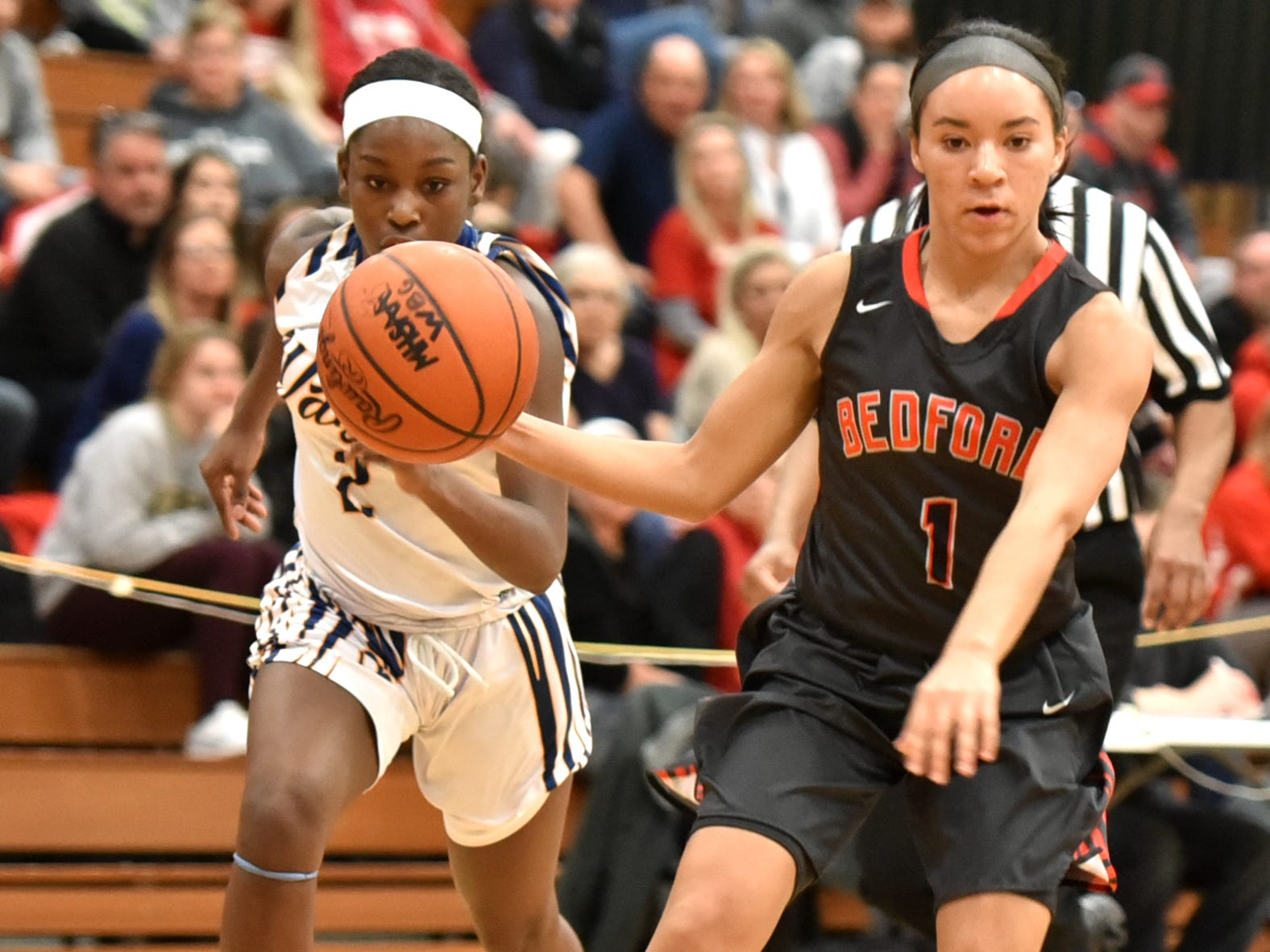 Wayne Memorial's Jordan Wright, left, keeps an eye on the ball that Temperance-Bedford's Selena Sandoval is dribbling. The Zebras stole an awful lot of balls from the team from Temperance.
