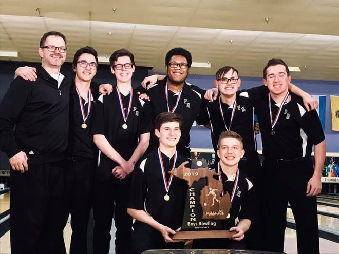 The Farmington-Harrison Unified Bowling Team shows off the program's first State Championship trophy.