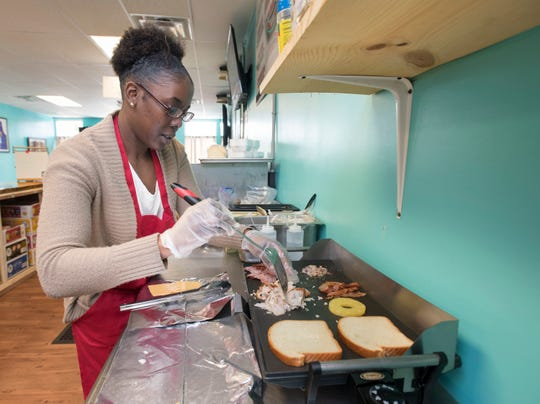 Daeshonaire Brooks assembles a Hawaiian Club - the most popular sandwich - at Fatboiz sandwich shop on North Pace Blvd. in Pensacola on Tuesday, March 19, 2019.