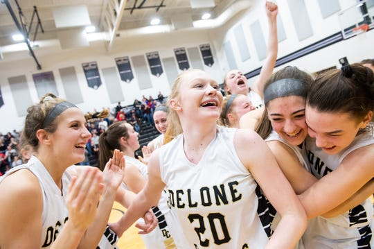 (From left) Delone Catholic players Maggie Wells, Brooke Lawyer, Maddie Sieg and Maggie Hughes celebrate with the rest of the Squirettes after defeating Central Cambria 47-39 in a PIAA 3A semifinal game in Lewistown, Pa., on Monday, March 18, 2019. The Squirettes will face Dunmore in the championship game at the Giant Center in Hershey Thursday at 6 p.m.