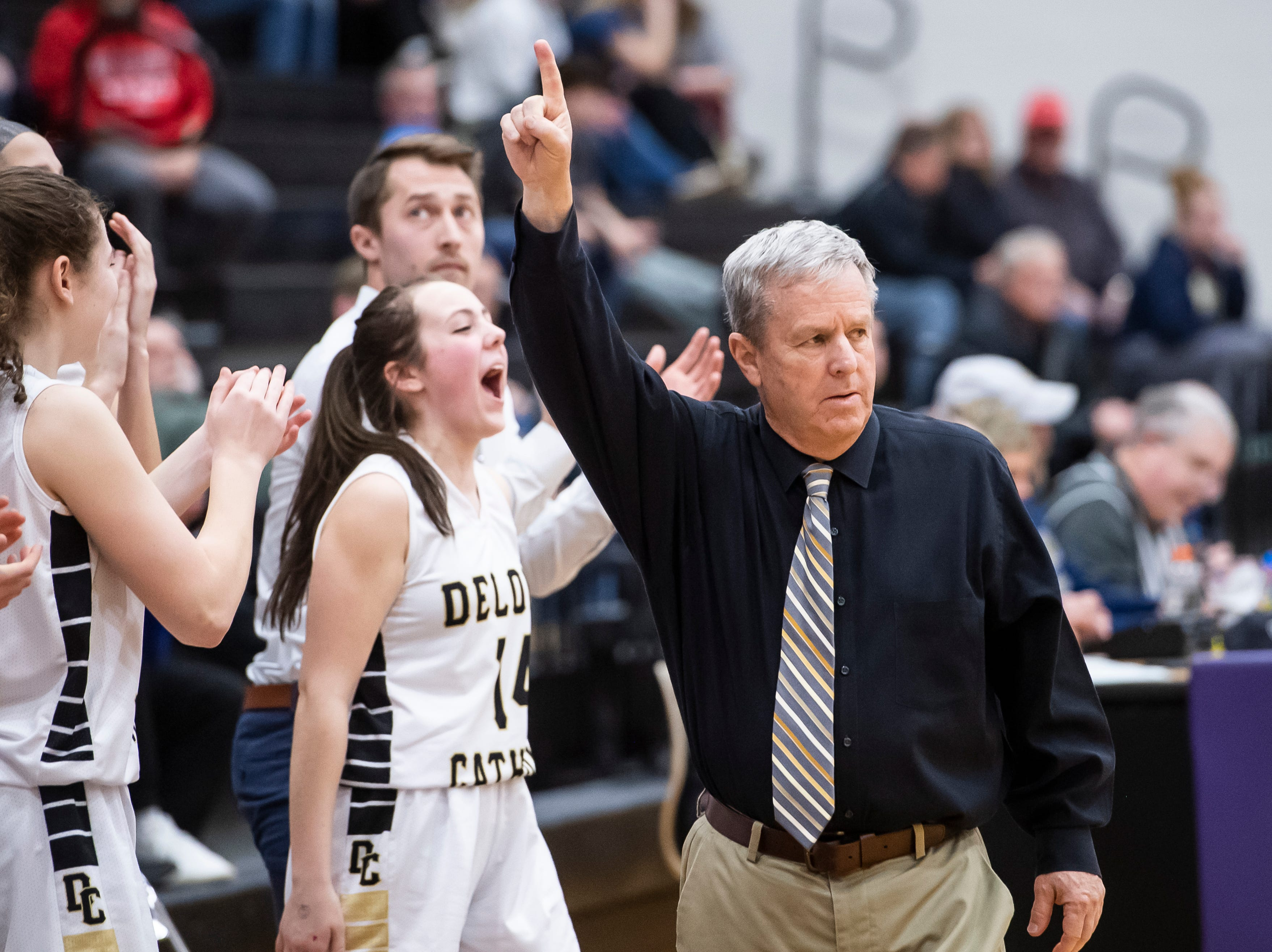 Delone Catholic head coach Gerry Eckenrode reacts after the Squirettes score late in the fourth quarter against Central Cambria during a PIAA 3A semifinal game in Lewistown, Pa., on Monday, March 18, 2019. The Squirettes won 47-39.