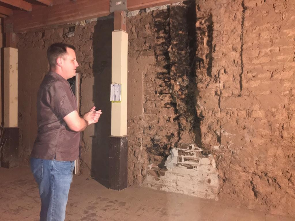 John Southard, Tempe's historic preservation officer, said crews discovered an old fireplace after peeling back plywood that covered the original adobe walls of the building.