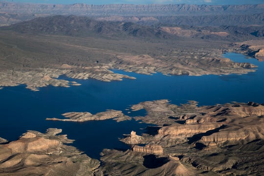 """Lake Mead near the Arizona/Nevada border March 18, 2019. A high-water mark or """"bathtub ring"""" is visible on the shoreline; Lake Mead is down 139 vertical feet."""