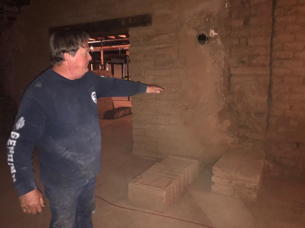 Adobe expert Reggie Mackay explains how there was likely a column separating a long room in the historic Hayden House.