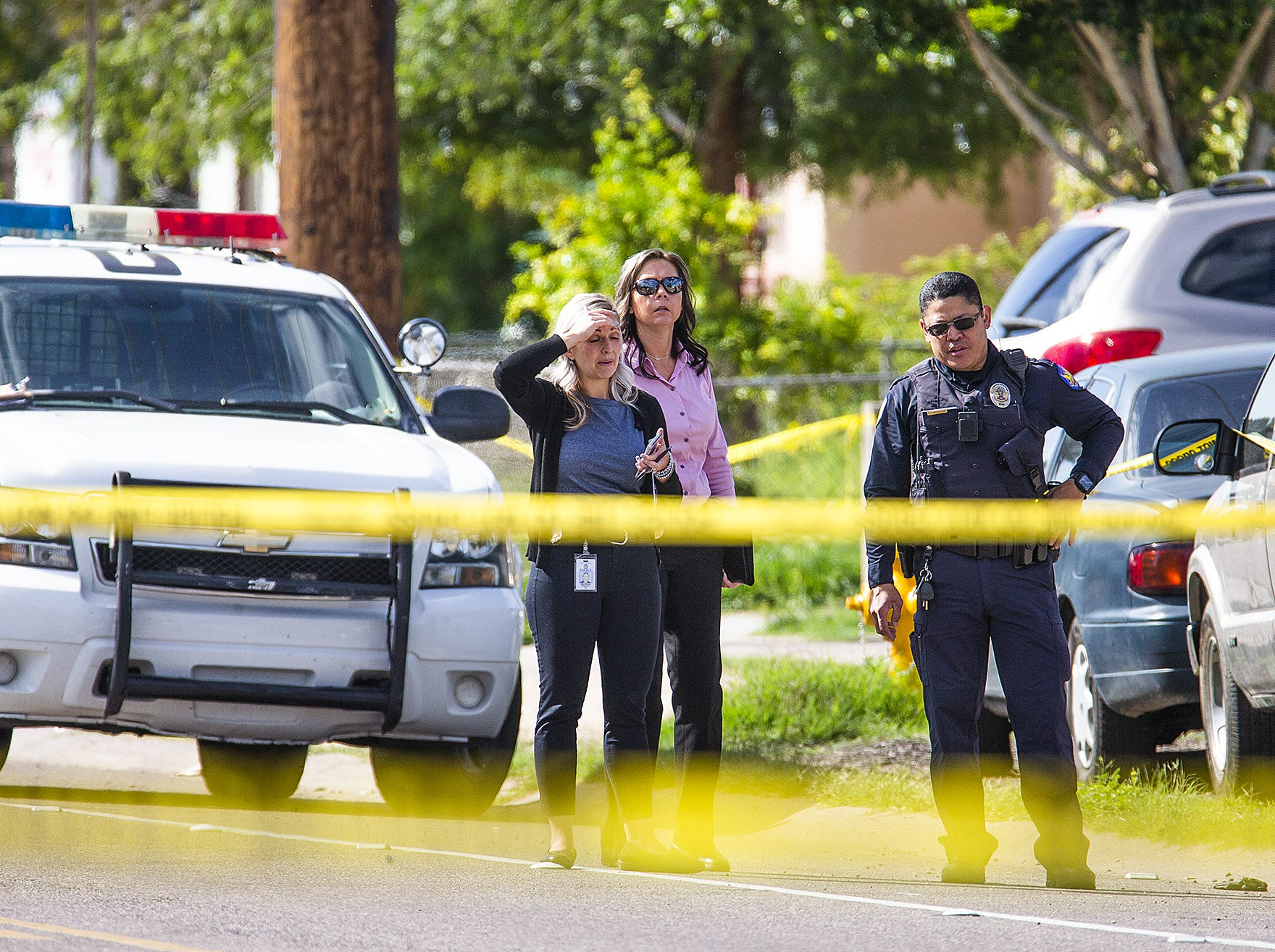 Phoenix police investigate the scene of a fatal shooting near Butler Drive and 27th Avenue in Phoenix on March 19, 2019.