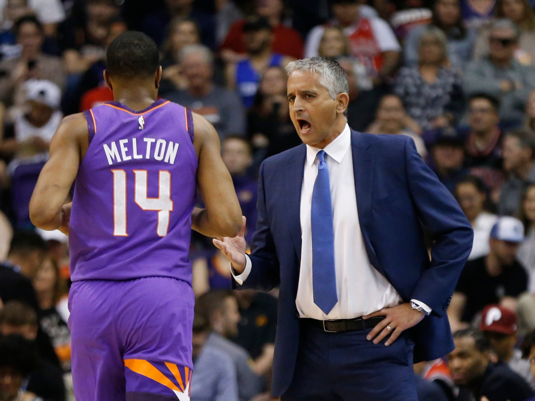 Suns' head coach Igor Kokoskov talks with point guard De'Anthony Melton (14) during the first half at Talking Stick Resort Arena in Phoenix, Ariz. on March 18, 2019.