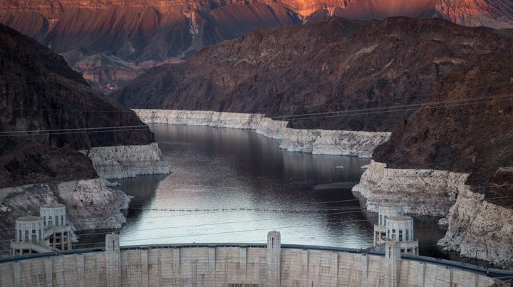 """Hoover Dam and Lake Mead March 17, 2019, photographed from the Mike O'Callaghan–Pat Tillman Memorial Bridge. A high-water mark or """"bathtub ring"""" is visible on the shoreline; Lake Mead is down 139 vertical feet."""