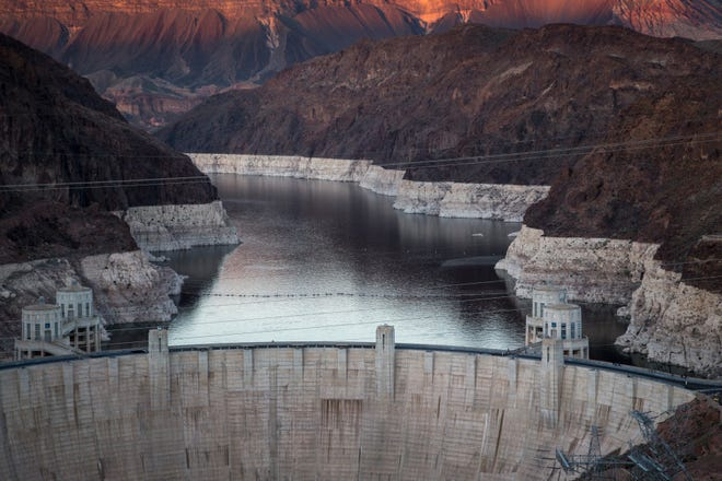 """Hoover Dam and Lake Mead on March 17, 2019. A high-water mark or """"bathtub ring"""" is visible on the shoreline."""