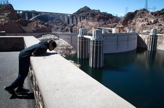 A visitor views Hoover Dam March 17, 2019, in the Lake Mead National Recreation Area near the Arizona/Nevada border.