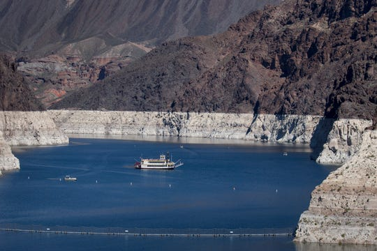 """Lake Mead's """"bathtub ring"""" is clearly visible as the Desert Princess, a three-level paddle-wheeler, cruises on March 17, 2019."""