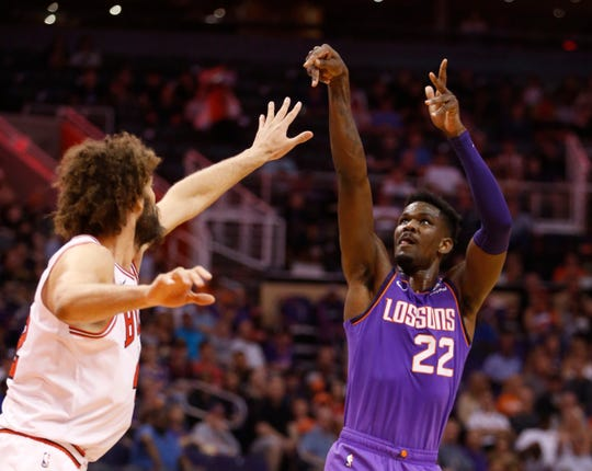 Suns' Deandre Ayton (22) shoots against Bulls' Robin Lopez (42) during the first half at Talking Stick Resort Arena in Phoenix, Ariz. on March 18, 2019.