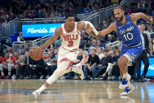 Chicago Bulls guard Shaquille Harrison (3) drives to the basket in front of Orlando Magic guard Evan Fournier (10) during the first half of an NBA basketball game Friday, Feb. 22, 2019, in Orlando, Fla. (AP Photo/Phelan M. Ebenhack)