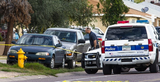 Phoenix police investigate the scene of a shooting near Butler Drive and 27th Ave. in Phoenix on March 19, 2019.