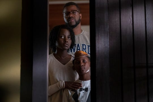 """Who is it? In """"Us,"""" Gabe (Winston Duke), Adelaide (Lupita Nyong'o) and their son (Evan Alex) are about to find out."""