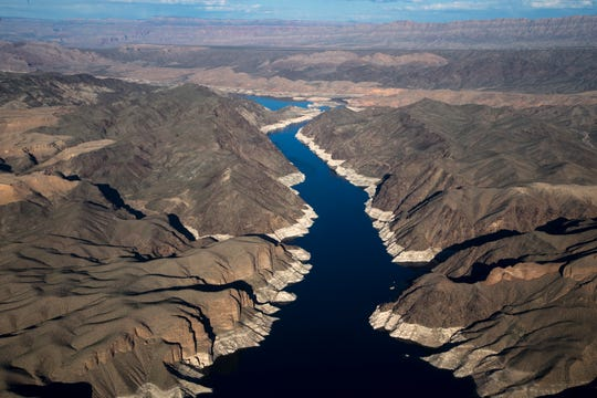 """Virgin Canyon leads into Gregg Basin, March 18, 2019, in the Lake Mead National Recreation Area near the Arizona/Nevada border. A high-water mark or """"bathtub ring"""" is visible on the shoreline; Lake Mead is down 139 vertical feet."""