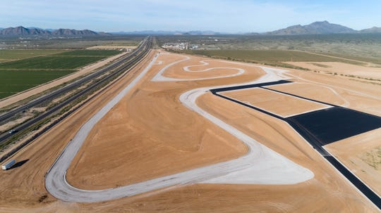 This photo shows the unfinished configuration of a 2.3 mile section of the Apex Motor Club track, looking to the west.