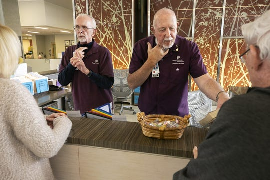 """Banner MD Anderson Cancer Center volunteers Dennis Swaney (left) and Robert """"Zac"""" Zakowski had cancer of the throat and larynx and had a laryngectomies. They now assists cancer patients at the hospital."""