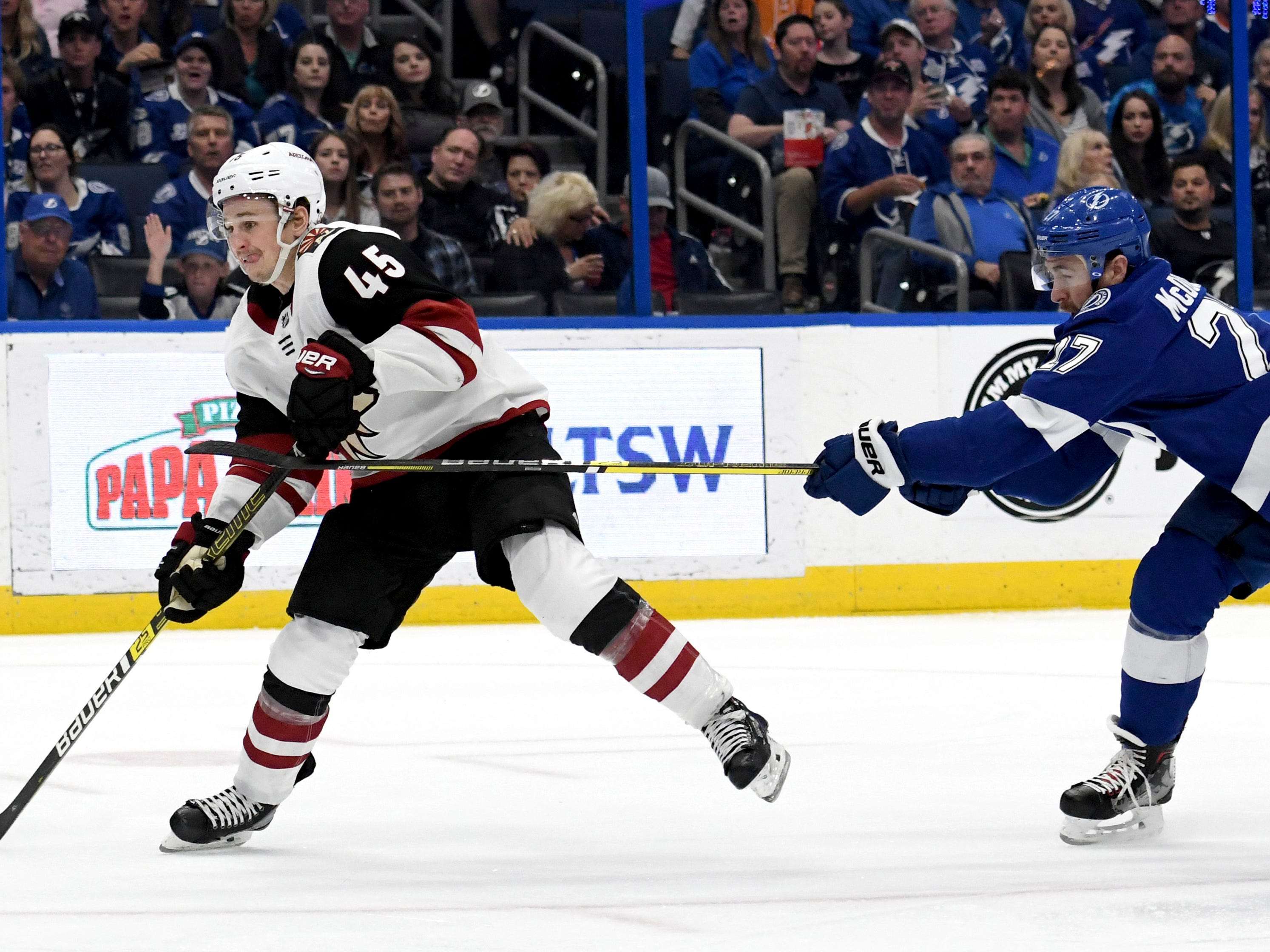 Arizona Coyotes right wing Josh Archibald (45) shoots as he gets past Tampa Bay Lightning defenseman Ryan McDonagh (27) during the first period of an NHL hockey game Monday, March 18, 2019, in Tampa, Fla.