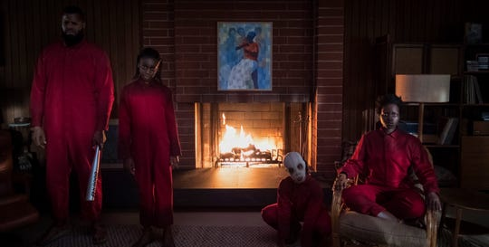 """In 'Us,"""" the Wilson family encounters a group of people who look just like them: Abraham (Winston Duke, from left), Umbrae (Shahadi Wright Joseph), Pluto (Evan Alex) and Red (Lupita Nyong'o)."""