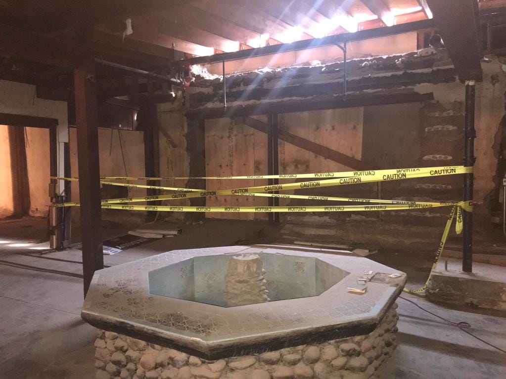 """The """"Fountain Room"""" inside Monti's steakhouse once was an outdoor courtyard. Crews will convert the room back into an outdoor space as part of the restoration."""
