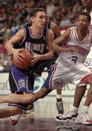 Sacramento Kings Bobby Hurley tries to drive past 76ers Allen Iverson during the first half of Friday, Jan. 24, 1997,  game in Philadelphia. (AP Photo/Rusty Kennedy)