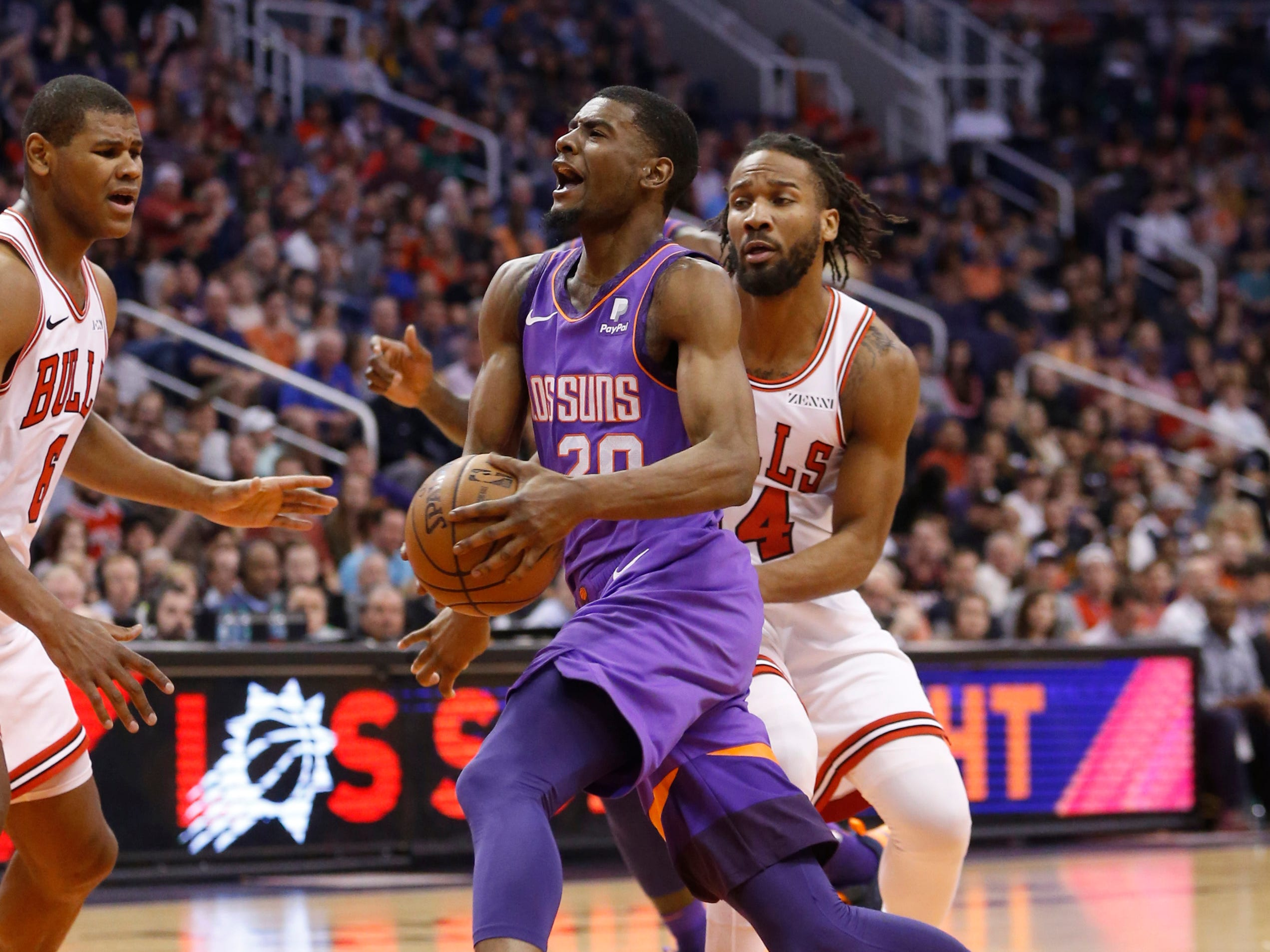 Suns' Josh Jackson (20) draws a shooting foul on Bulls' Wayne Sheldon Jr. during the second half at Talking Stick Resort Arena in Phoenix, Ariz. on March 18, 2019.