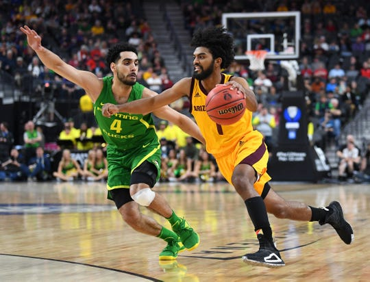 Arizona State guard Remy Martin (1) drives against Oregon guard Ehab Amin (4) during the second half of a Pac-12 Tournament semifinal game at T-Mobile Arena.
