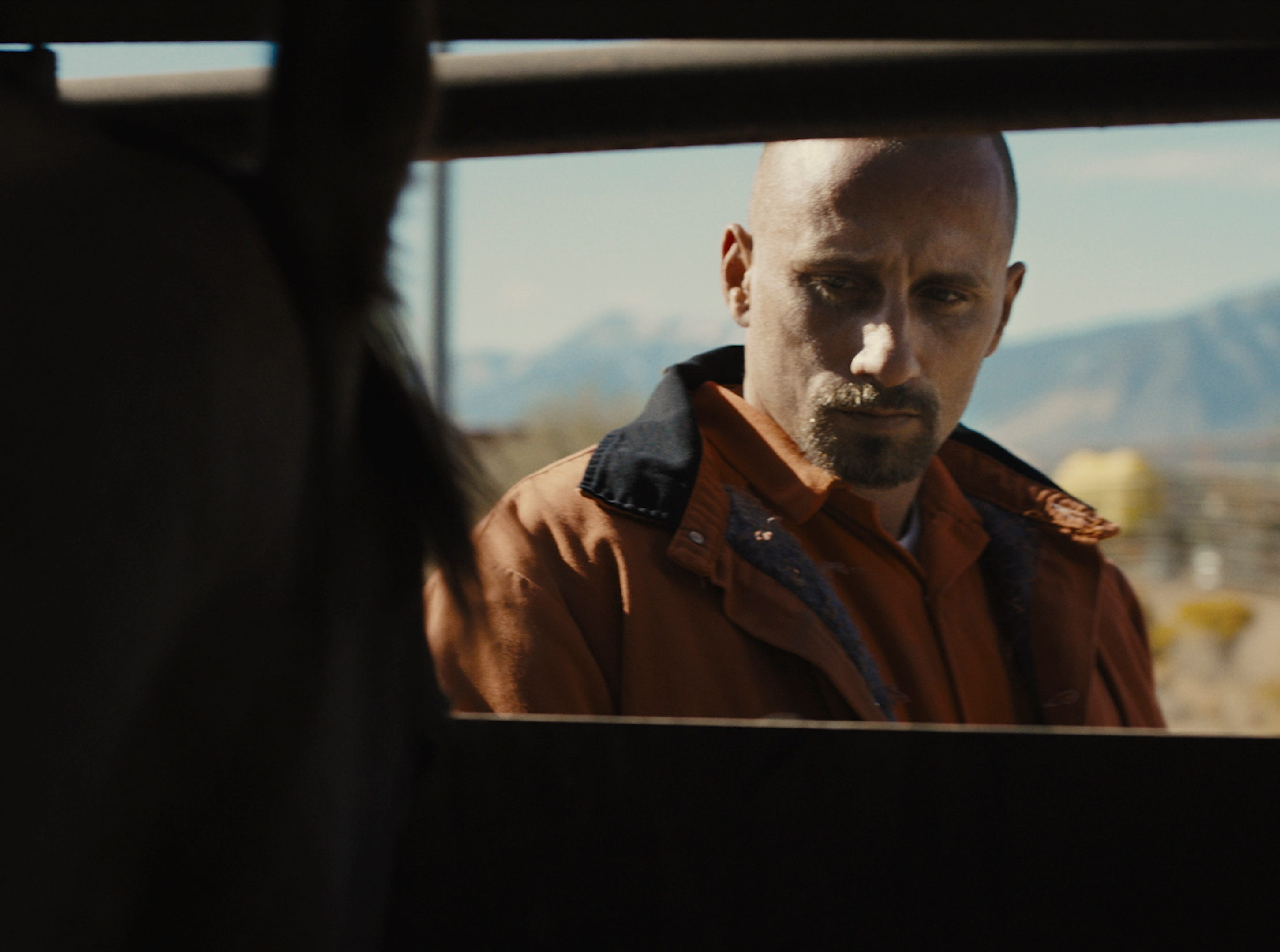 "Roman (Matthias Schoenaerts) makes an emotional connection with a horse in ""The Mustang."""