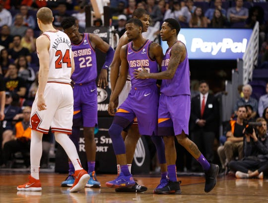 Suns' Jamal Crawford (11) pushes Josh Jackson away from an official after being called for a technical during the second half against the Bulls at Talking Stick Resort Arena in Phoenix, Ariz. on March 18, 2019.