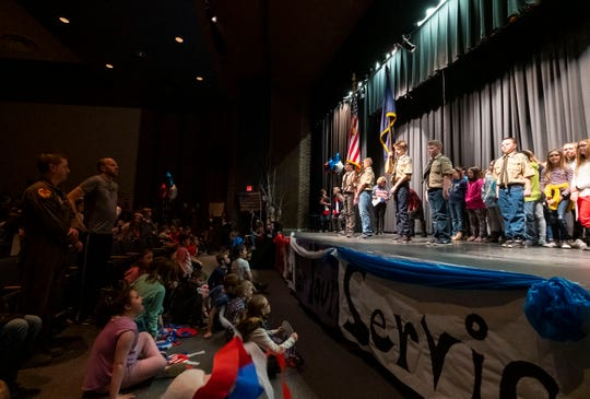 Algonquin Elementary PE teacher and U.S. Tech Sgt. Jeff Luts, second from left, stands while members of Boy Scout Troop 252 present the national colors before leading Algonquin Elementary students and faculty in the Pledge of Allegiance Tuesday, March 19, 2019 in the school's auditorium.