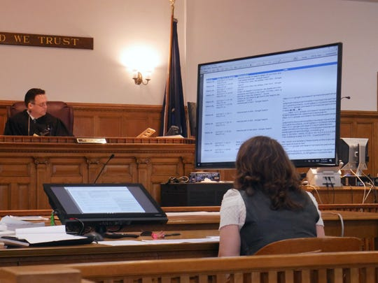 Dutchess County Court Judge Edward McLoughlin and Putnam County Assistant District Attorney Chana Krauss, whose office is handling the Nicole Addimando case as special prosecutor, sit before a screen containing an exhibit on March 19, 2019. The exhibit contains a list of website searches made on Sept. 27, 2017, hours before Christopher Grover was found shot to death.