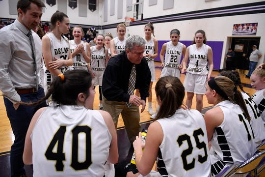 Delone Catholic girls' basketball coach Gerry Eckenrode talks to his players during a 2019 state playoff game.