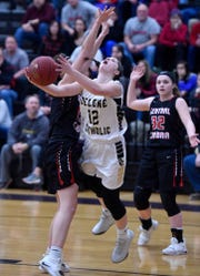 Delone Catholic's Gianna Hoddinott drives to the basket vs. Central Cambria in a PIAA Class 3-A semifinal game.