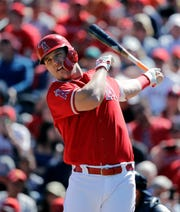 Los Angeles Angels' Mike Trout takes a warm-up swing before batting against the Seattle Mariners in a spring training baseball game Sunday, March 10, 2019, in Tempe, Ariz. (AP Photo/Elaine Thompson)