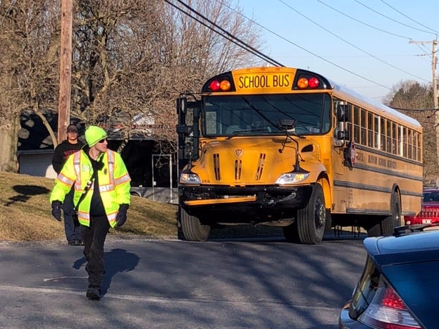 An emergency responder surveys the scene following a two-vehicle crash involving a school bus carrying about 25 York County School of Technology students at Hollywood Drive and Midland Avenue on March 19, 2019. (Dawn J. Sagert photo)