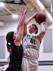 Delone's Brandi Zumbrum looks to shoot while covered by Jenna Bauer of Central Cambria, Monday, March 18, 2019.