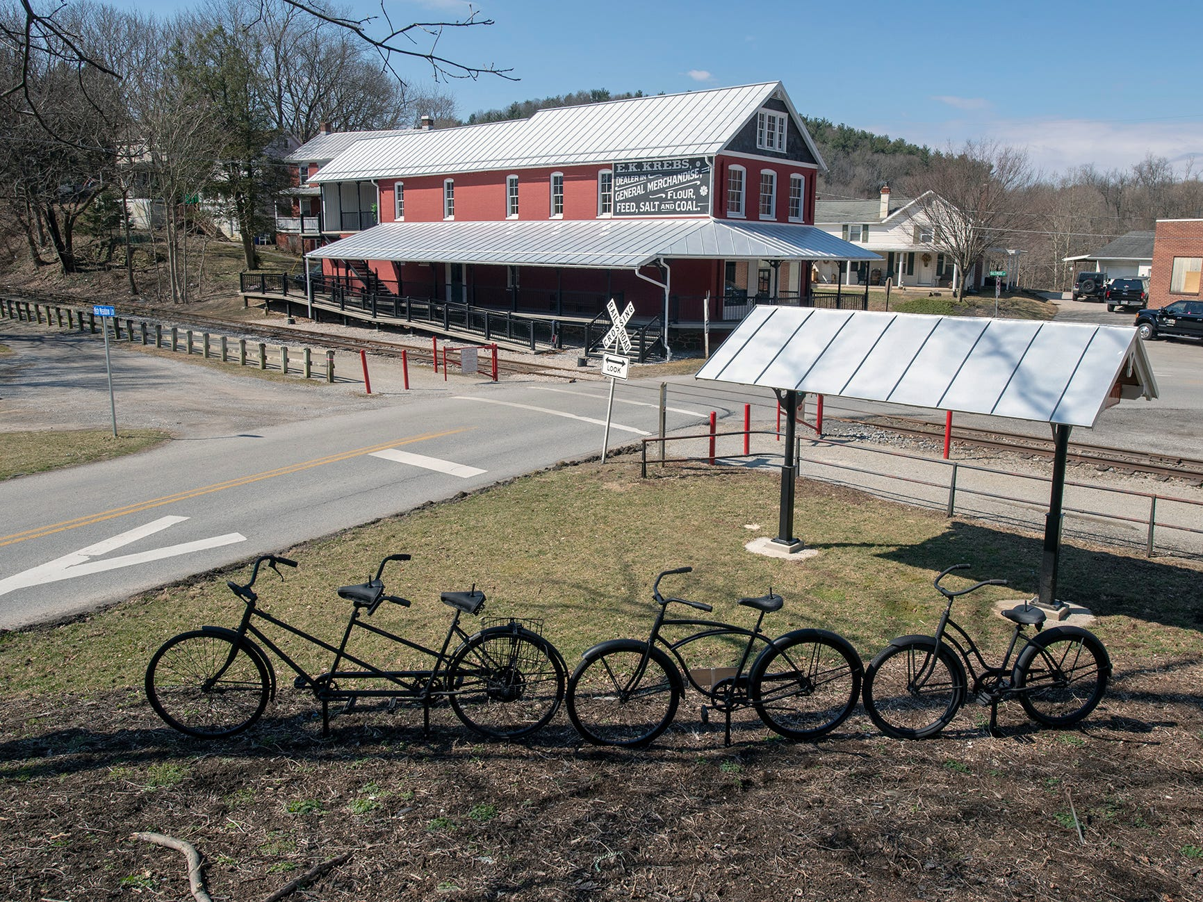 The area in the foreground was cleaned out and a bicycle sculpture added by David Keller and Ellen Darby. The couple also built a new Seitzland train station and they hope to lay a brick walking surface around it. The Seitzland store is in the background.