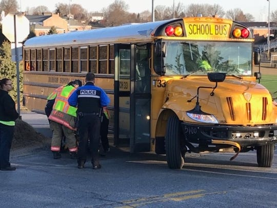 Emergency personnel attend to an injured student in a crash involving a school bus at Midland Avenue and Hollywood Drive in Spring Garden Township.