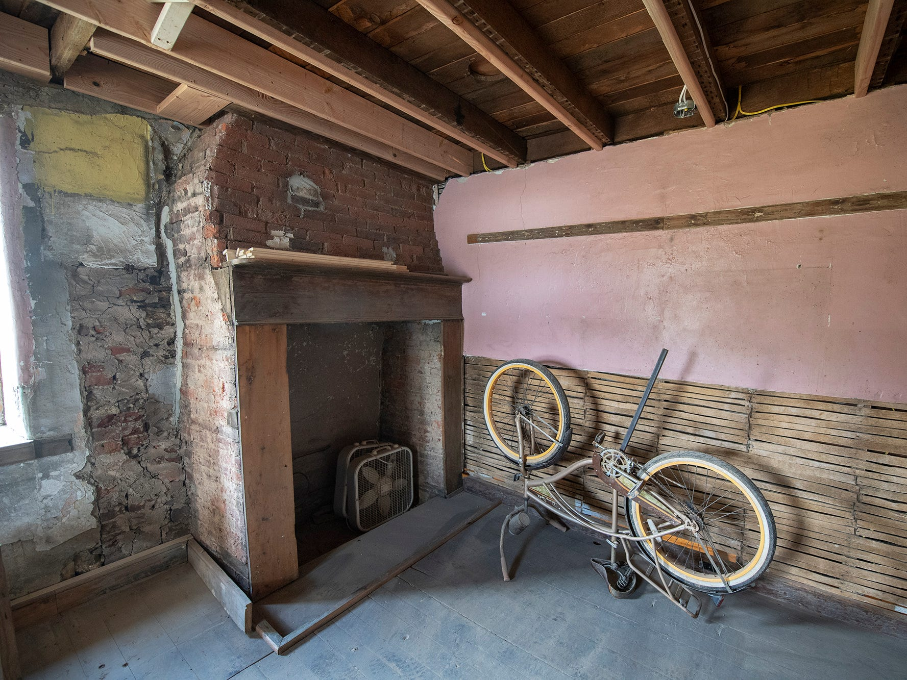 This is looking at a first-floor fireplace in the stone building under renovation in Seitzland Village outside of Glen Rock.
