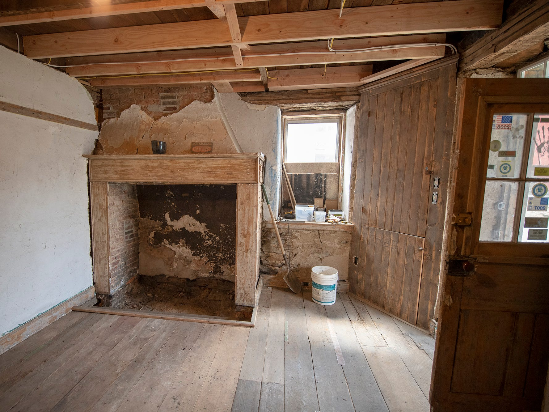 This is looking at the fireplace inside the stone building under renovation in Seitzland Village outside of Glen Rock.