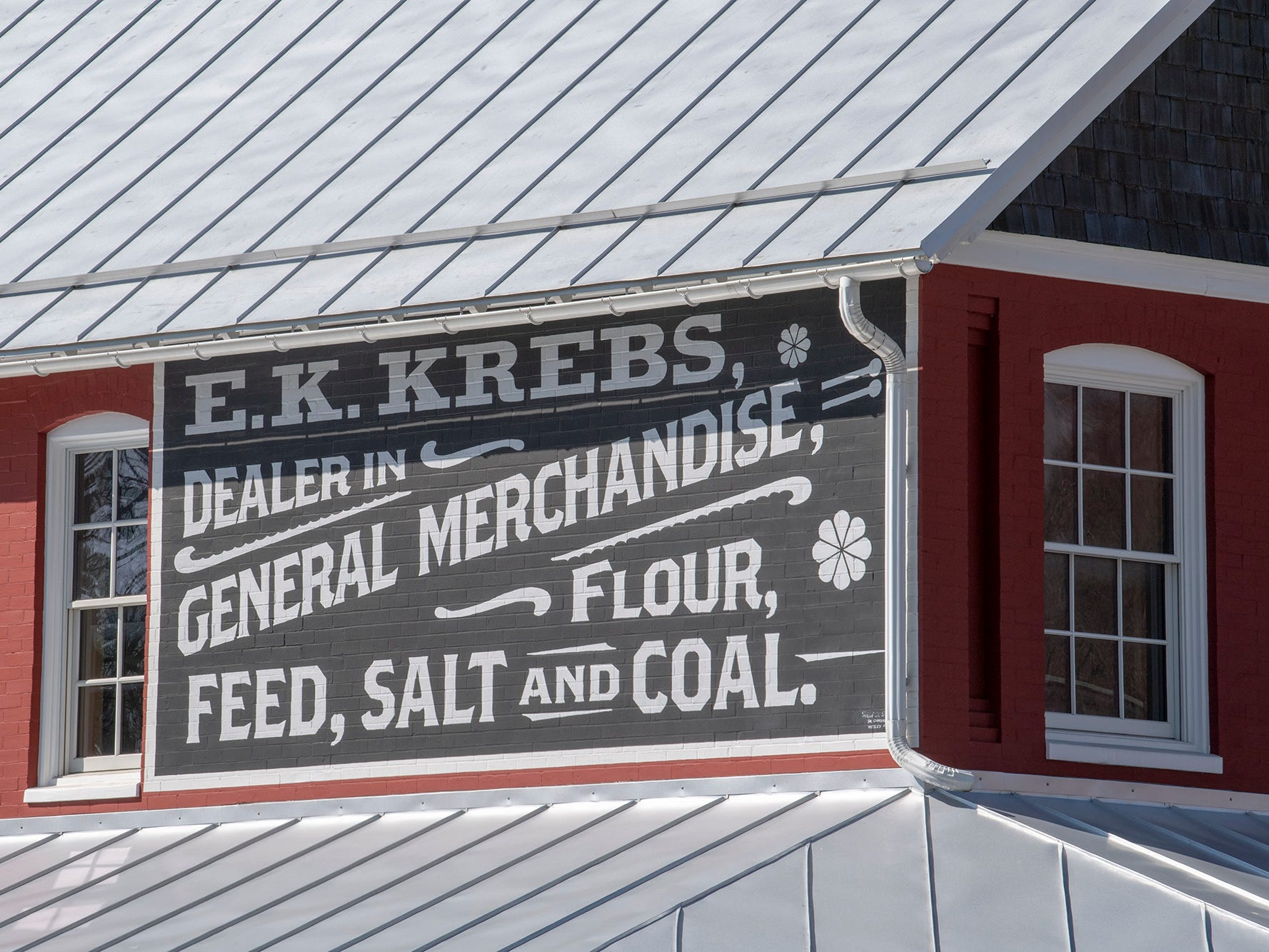 David Keller used an old photo of the building to recreate the painted sign that is seen today on the side of the building. He also installed a new, traditional standing seam roof using old methods to install it.