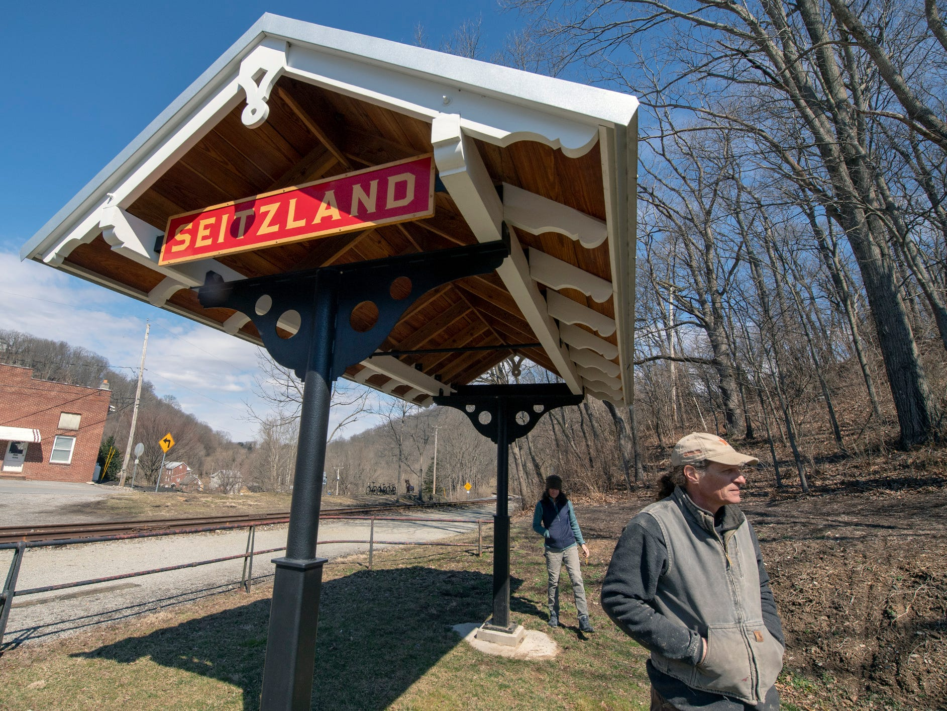 David Keller, right, and Ellen Darby stand at the Seitzland train station they built next to the York County Heritage Rail Trail.
