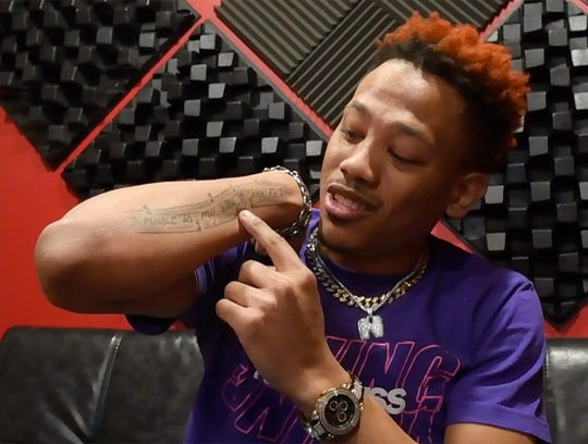 """Music artist Terrell Bryant, whose stage name is Nakuu, shows the ink on his arm that says """"music is my way of live""""  at Studio 117 in York."""